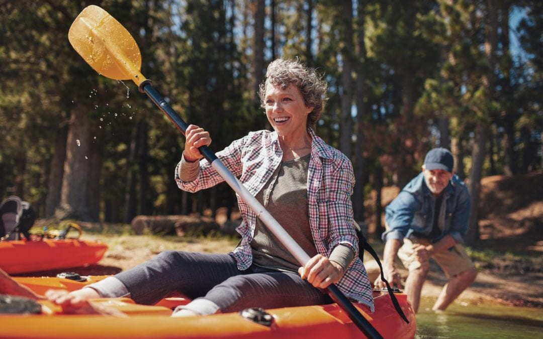 Lady having fun on kayak on a lake