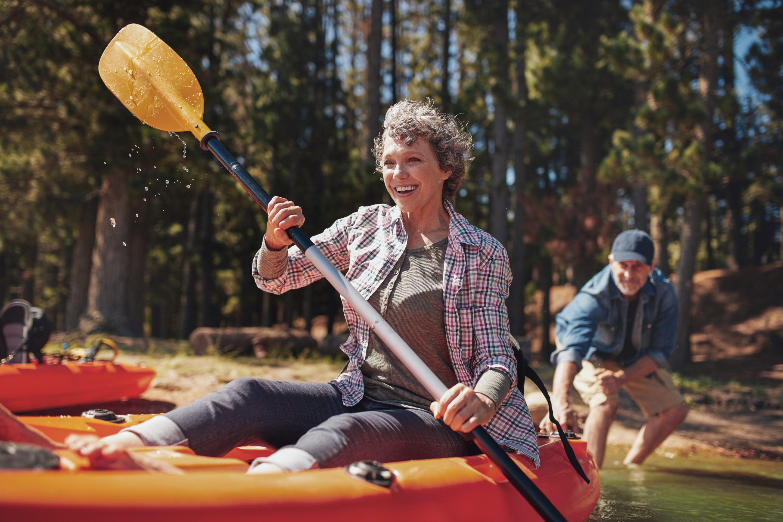 Mature couple enjoying a day at the lake with kayaking | Beltone Hearing