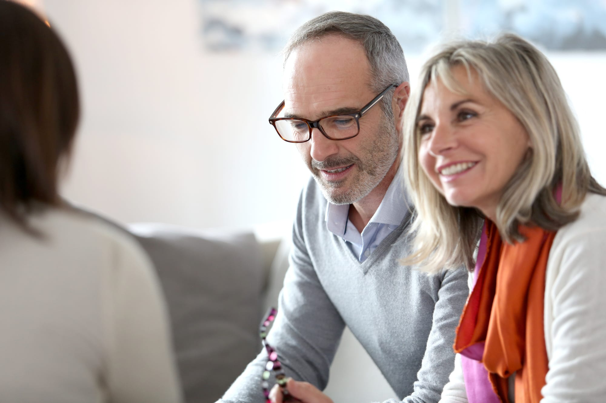 Senior couple meeting financial adviser | Beltone Hearing Aid
