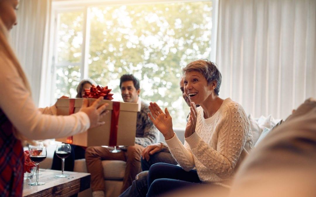 Mature woman recieving christmas gift