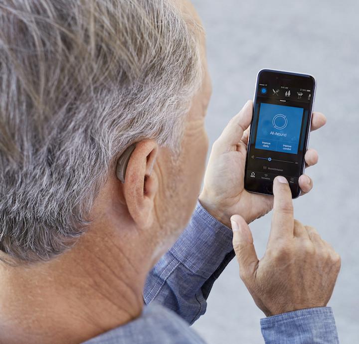 Elderly man using a smartphone