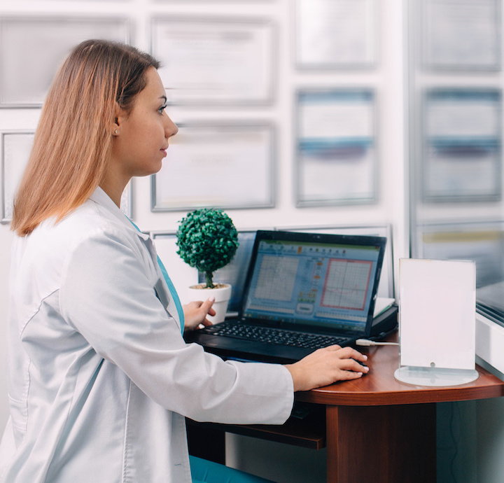 Hearing specialist sat at a desk